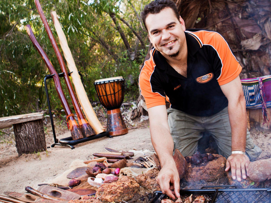 Chef Josh Whiteland grills outdoors